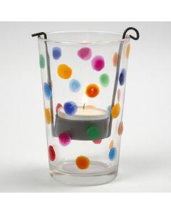 Un bougeoir décoré avec des points de couleur