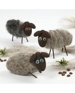 Un mouton fait en polystyrène avec de la laine feutrée à l'aiguille
