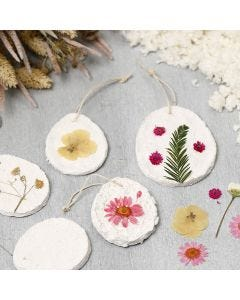 Hanging decorations from papier-mâché pulp decorated with dried flowers