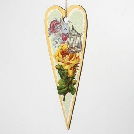 Décorations printanières faites à partir de formes en bois avec découpages