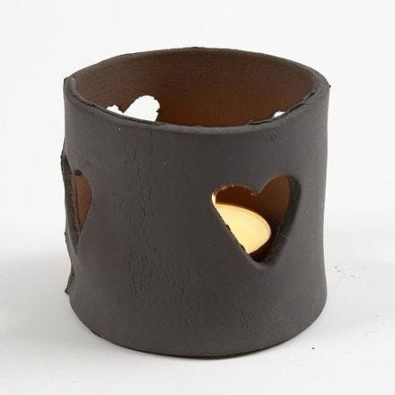 A Candle Holder made from Black Self-Hardening Clay