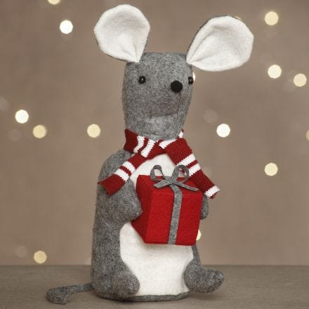 A felt Christmas mouse with a present