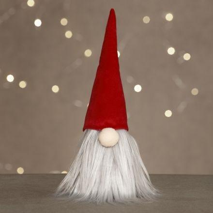 Un lutin avec un gros nez, une longue barbe et un bonnet de lutin en velours