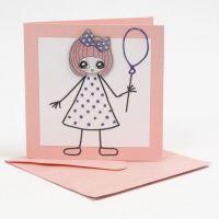 Une carte avec une petite fille en stickers