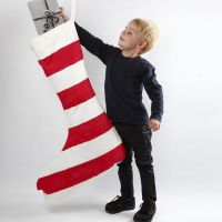 A huge Christmas Stocking with red-painted Stripes