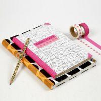 Un cahier d'école avec du papier d'emballage de chez Vivi Gade