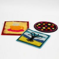 A Trivet made from thick Felt with needle felted Decoration