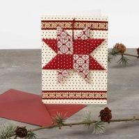 Une carte de Noël avec une étoile tissée