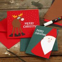 Carte de voeux avec des dessins de Noël faits en papier cartonné