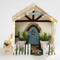 Une petite maison féérique dans une boîte de rangement