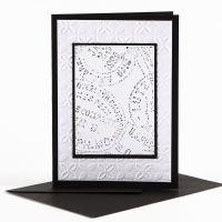 Une carte de voeux avec des décorations en relief et des pastels de cire