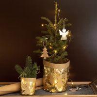 Un pot de fleur recouvert de papier imitation cuir décoré de dessin de Noël