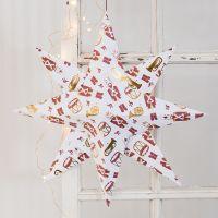 Une grande étoile pliée dans du papier design au motif de casse-noisette