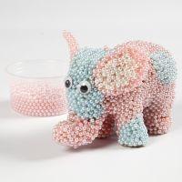 Un éléphant en papier mâché recouvert de Pearl Clay