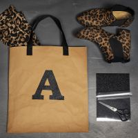 Film à repasser sur un sac en papier imitation cuir