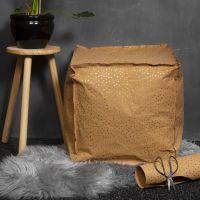 Un pouf en papier imitation cuir rempli de billes de polysytrène