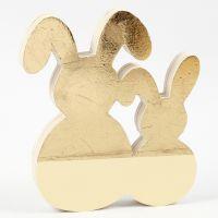 Un lapin de Pâques décoré avec un film décoratif doré et de la peinture acrylique