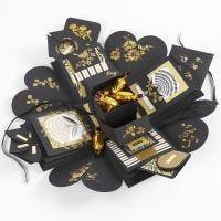 Une boîte à explosion comme cadeau contenant de l'argent et du chocolat