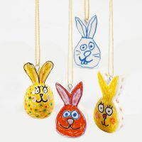 Porcelain Easter rabbits decorated with glass and porcelain markers