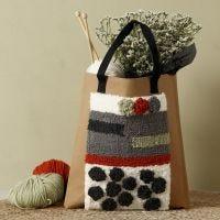 Application du poinçon à broderie sur un sac à provisions en papier imitation cuir