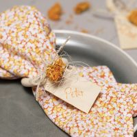 Napkins made from patchwork fabric and a napkin ring decorated with dried flowers