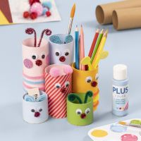 A pencil holder from cardboard tubes decorated with craft paint and basic craft materials