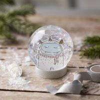 A snow globe with a drawing and glitter